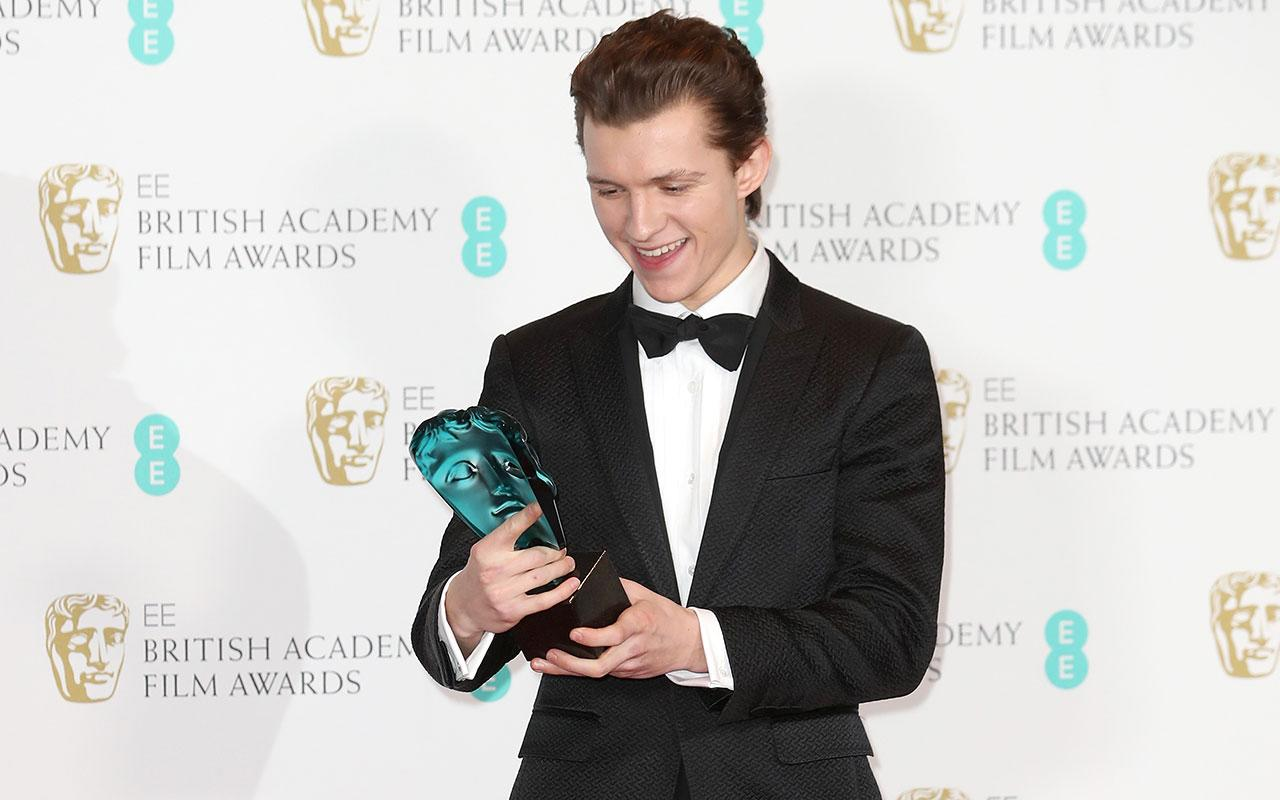 EE Rising Star winner actor Tom Holland poses with his award in the winners room during the 70th EE British Academy Film Awards (BAFTA) at Royal Albert Hall on February 12, 2017 in London, England. (Photo by Chris Jackson/Getty Images)