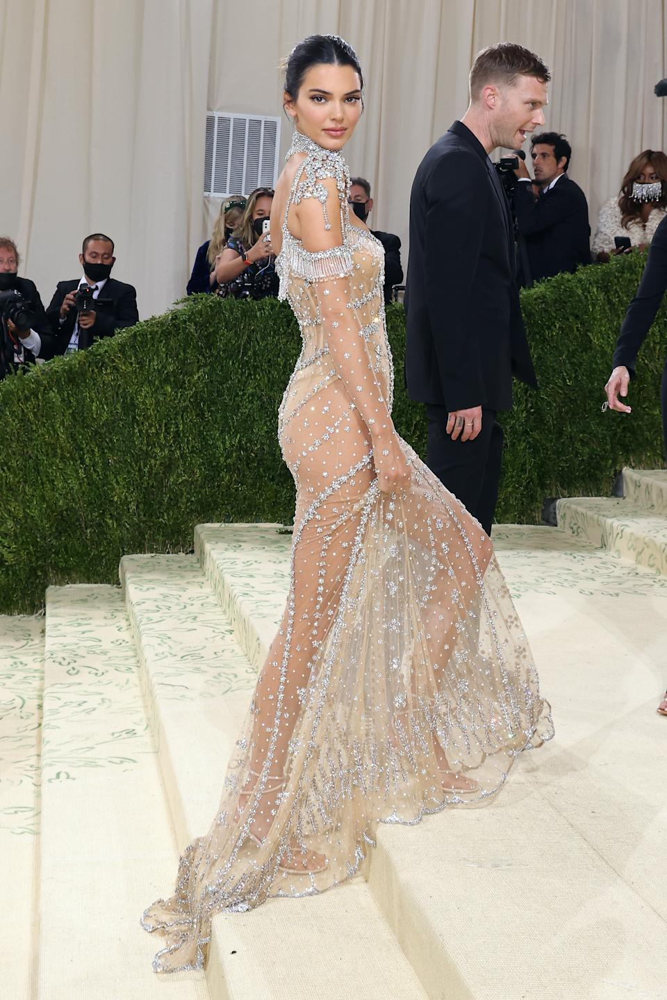 Kendall Jenner wears a sheer silver dress at the 2021 Met Gala benefit
