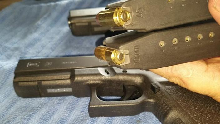 a picture of a Glock 20 and a Glock 21