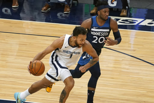 Memphis Grizzlies' Kyle Anderson (1) races to the basket with Minnesota Timberwolves' Josh Okogie (20) in pursuit in the first half of an NBA basketball game, Wednesday, Jan. 13, 2021, in Minneapolis. (AP Photo/Jim Mone)