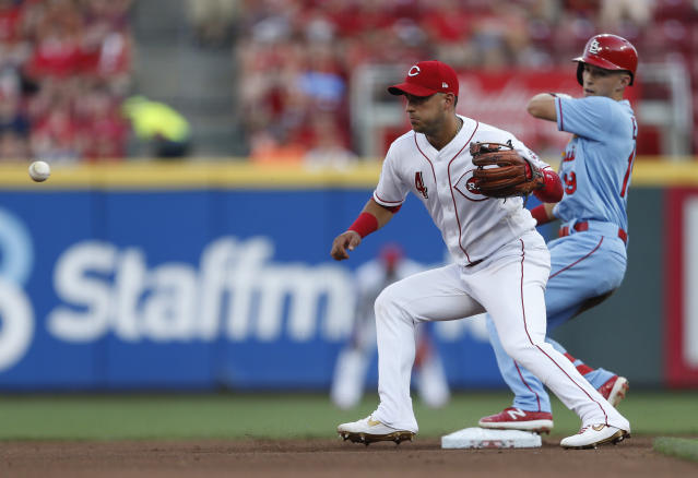 St. Louis Cardinals' Tommy Edman, right, is safe at second base with a double as Cincinnati Reds shortstop Jose Iglesias (4) takes the throw during the fourth inning of a baseball game, Saturday, July 20, 2019, in Cincinnati. (AP Photo/Gary Landers)
