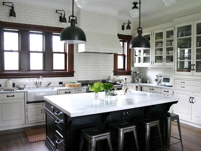 <p>Upon first glance, this subway tile backsplash may not seem extraordinary, but by continuing the tile all the way to the ceiling, the room feels larger, the walls are easy to clean, and the kitchen boasts more texture and interest. </p>