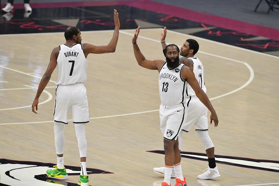 Kevin Durant, James Harden and Kyrie Irving might be the most talented trio in NBA history. (Jason Miller/Getty Images)