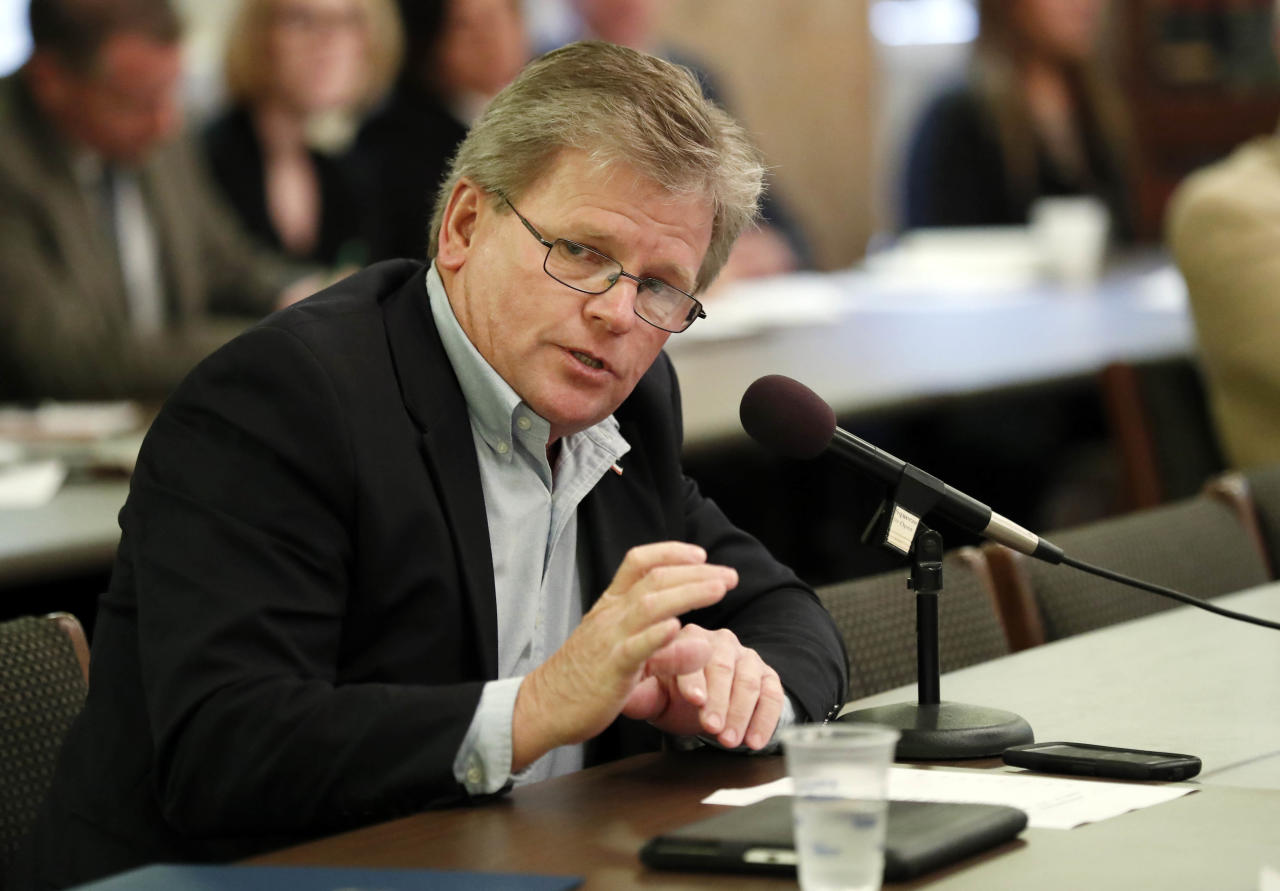 FILE - In a Tuesday, Dec. 19, 2017 file photo, Rep. Doug McLeod, R-Lucedale, questions a health care witness at a House Medicaid Committee hearing, at the Capitol in Jackson, Miss. McLeod of Lucedale was arrested Saturday, May 18, 2019 on a misdemeanor domestic violence charge. McLeod punched his wife in the face after she didn't undress quickly enough when the lawmaker wanted to have sex, according to a police report in the case.(AP Photo/Rogelio V. Solis, File)