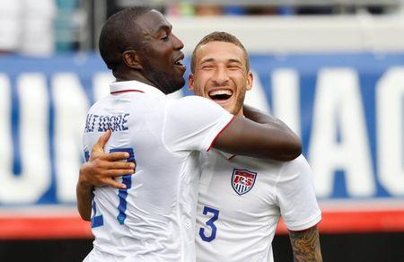 United States forward Jozy Altidore (17) is congratulated by defender Fabian Johnson (23) after Altidore scored against the Nigeria at EverBank Field. Mandatory Credit: Kim Klement-USA TODAY Sports