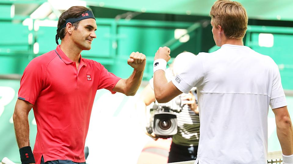 Roger Federer and Ilya Ivashka, pictured here after their match in Halle.