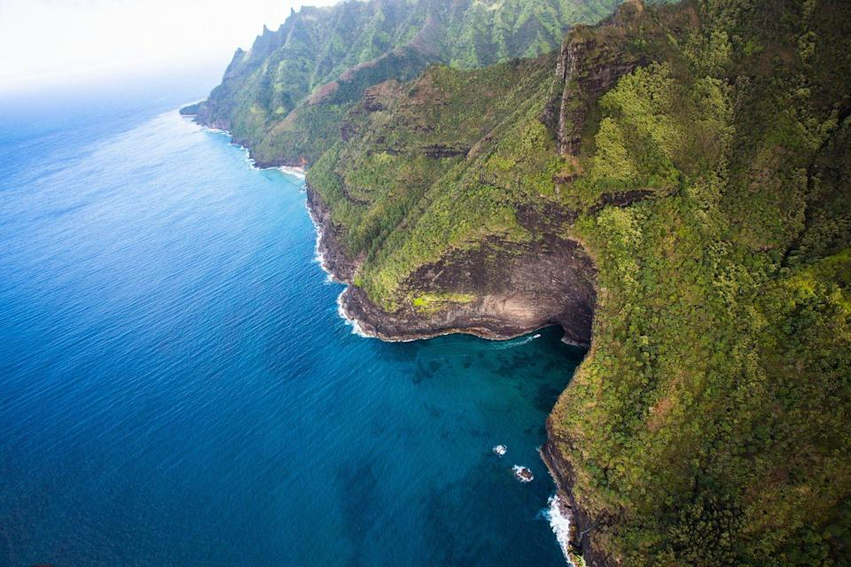 """<p>Along the island of <a href=""""http://www.napaliriders.com/sea-caves-kauai-na-pali-coast/"""" rel=""""nofollow noopener"""" target=""""_blank"""" data-ylk=""""slk:Kauai's Na Pali Coast"""" class=""""link rapid-noclick-resp"""">Kauai's Na Pali Coast</a>, you will find a number of gaping sea caves. Formed by harsh waves slamming into the island's porous lava rock, the caves now provide the perfect place for kayakers and other adventure-seekers to get up close and personal with the land.</p>"""