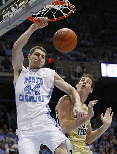 North Carolina's Tyler Zeller (44) dunks over Georgia Tech's Daniel Miller during the first half of an NCAA college basketball game in Chapel Hill, N.C., Sunday, Jan. 29, 2012. (AP Photo/Gerry Broome)