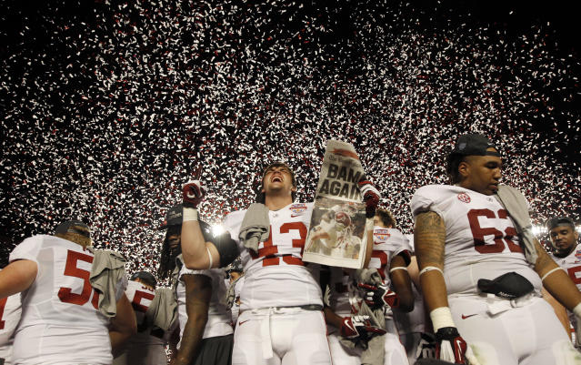 Alabama Crimson Tide's Cade Foster (C) celebrates next to teammate Brandon Ivory (R) after they defeated the Notre Dame Fighting Irish at their NCAA BCS National Championship college football game in Miami, Florida January 7, 2013. REUTERS/Jeff Haynes (UNITED STATES - Tags: SPORT FOOTBALL)