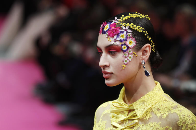 Flowers framed the face at Alexis Mabille.