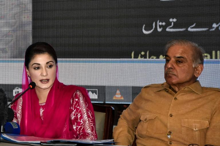 Three Pakistani TV channels had their broadcasts cut, after screening a press conference with opposition leader Maryam Nawaz (L)