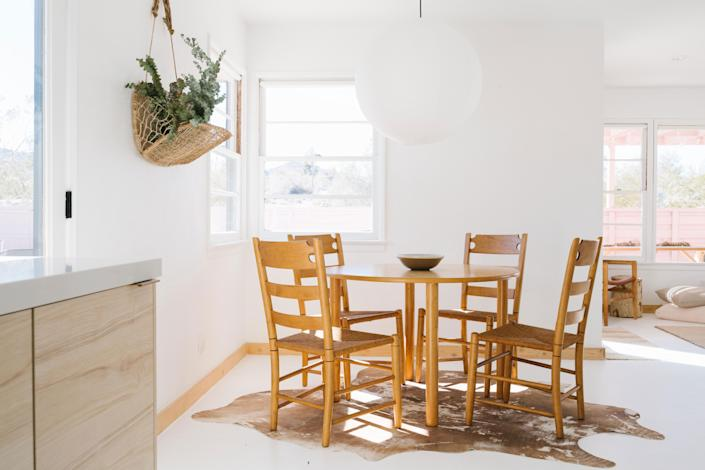 """<div class=""""caption""""> Even if your at-home workspace is a seat at the dining room table, make sure you keep it clean and clutter-free at the end of each day. </div> <cite class=""""credit"""">Alison Bernier</cite>"""