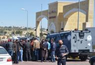 People gather outside the new Salt government hospital in the city of Salt