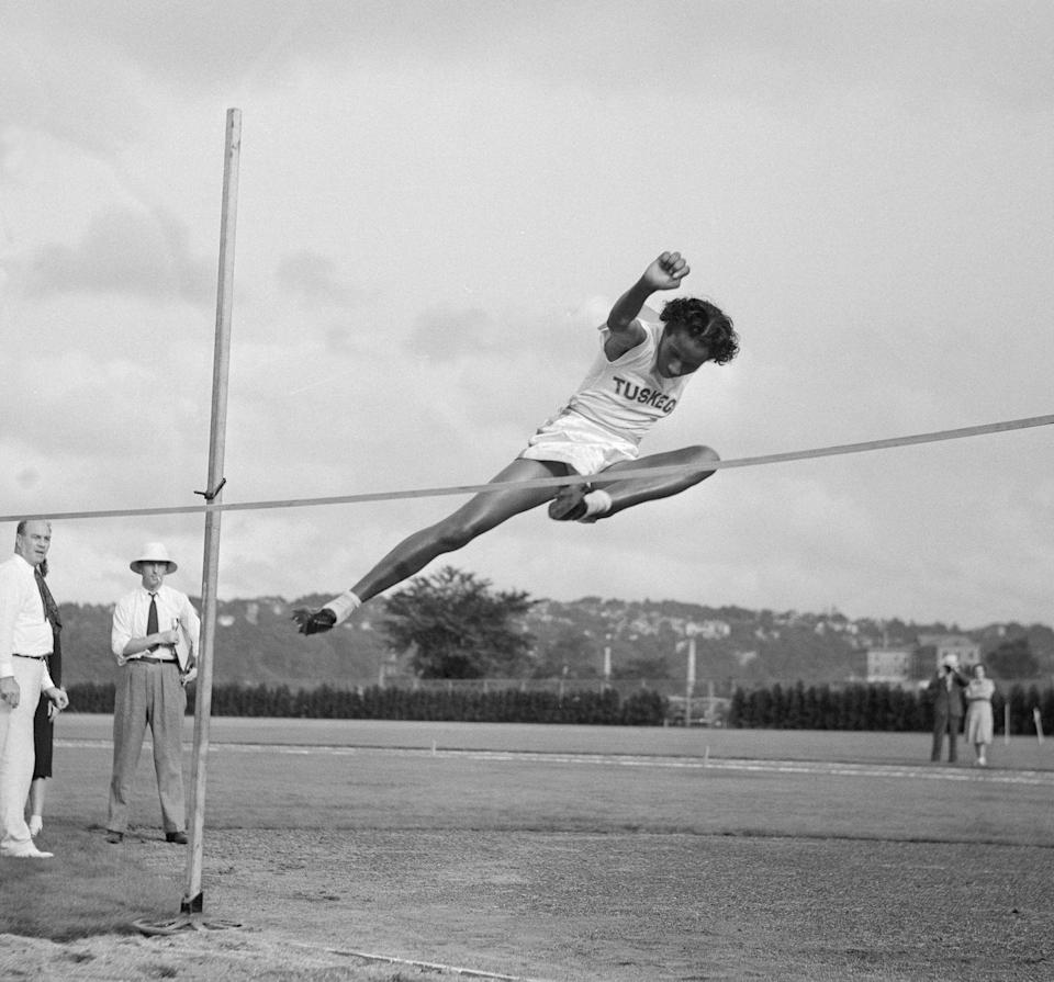 """<p>Growing up in Albany, Georgia, the soon-to-be track star got an early start running on dirt roads and jumping over makeshift hurdles. She became the first African American woman from any country to win an Olympic Gold Medal at the <a href=""""https://www.olympic.org/news/alice-coachman-athletics"""" rel=""""nofollow noopener"""" target=""""_blank"""" data-ylk=""""slk:1948 Summer Olympics"""" class=""""link rapid-noclick-resp"""">1948 Summer Olympics</a> in London. She set the record for the high jump at the Games, leaping to 5 feet and 6 1/8 inches. Throughout her athletic career, she won 34 national titles—10 of which were in the high jump. She was officially inducted into the National Track-and-Field Hall of Fame in 1975 and the U.S. Olympic Hall of Fame in 2004. </p>"""