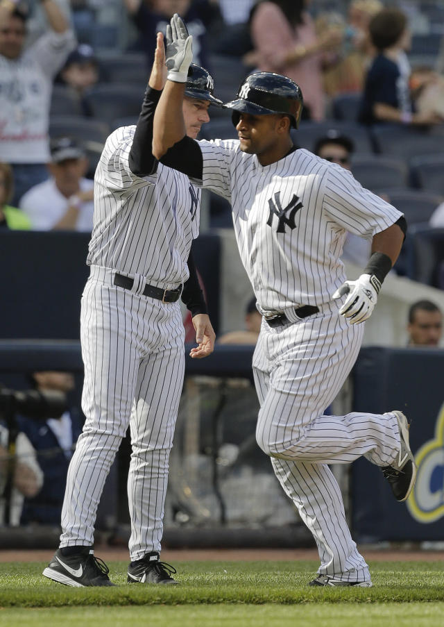 New York Yankees' Zoilo Almonte (24) is congratulated by third base coach Rob Thompson after hitting a solo home run during the third inning of a baseball game against the Pittsburgh Pirates, Saturday, May 17, 2014, in New York. (AP Photo/Julie Jacobson)