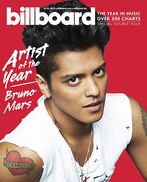 This image provided by Billboard shows Artist of the Year Bruno Mars on the cover of Billboard magazine. Billboard announced Friday, Dec. 13, 2013, that the pop crooner is the year's top overall artist. (AP Photo/Billboard, Kai Z. Feng)