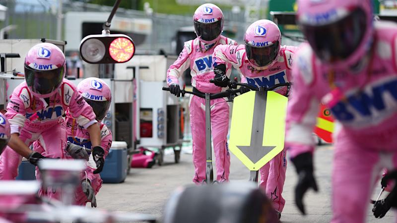 Pictured here, Racing Point team members assemble in the pit stop.