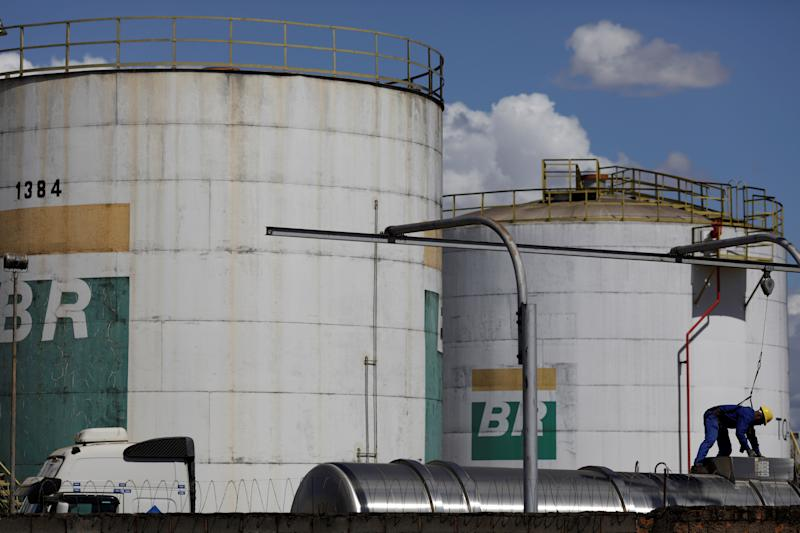 A worker stands near a tank of Brazil's state-run Petrobras oil company in Brasilia, Brazil July 25, 2019. REUTERS/Ueslei Marcelino