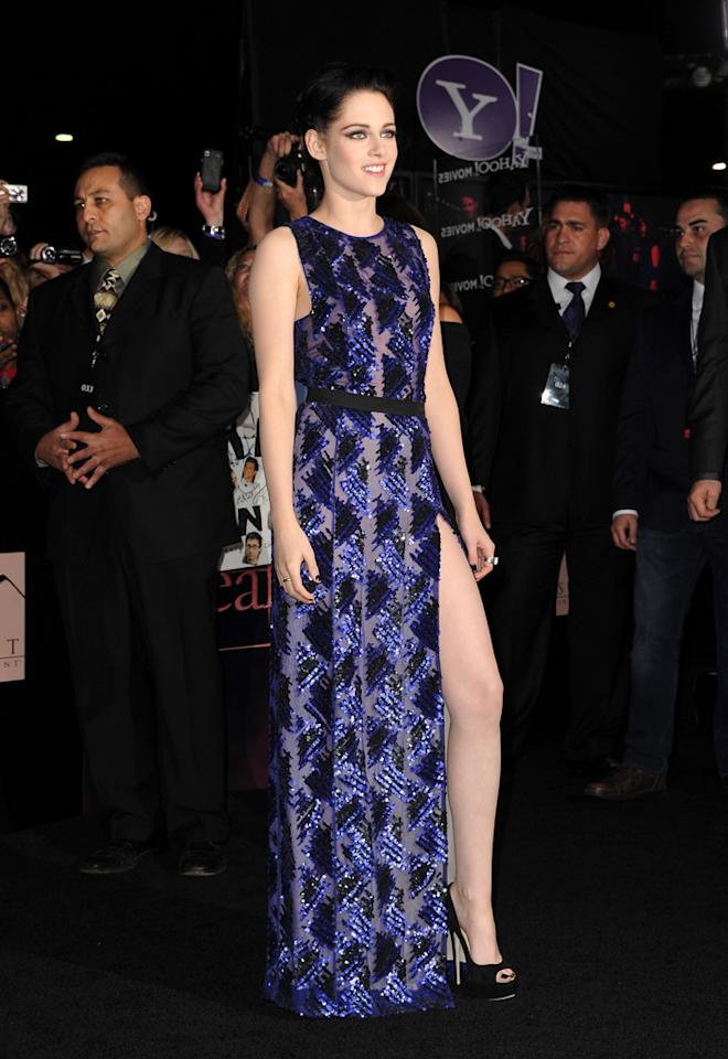 "Kristen Stewart breaks from her signature style at the ""Breaking Dawn - Part 1"" premiere with a long, sequined J. Mendel gown featuring a daring slit, Jimmy Choo heels and a dramatic Neil Lane amethyst, diamond and white gold ring worth $18,000. (Photo by Kevin Winter/Getty Images)"
