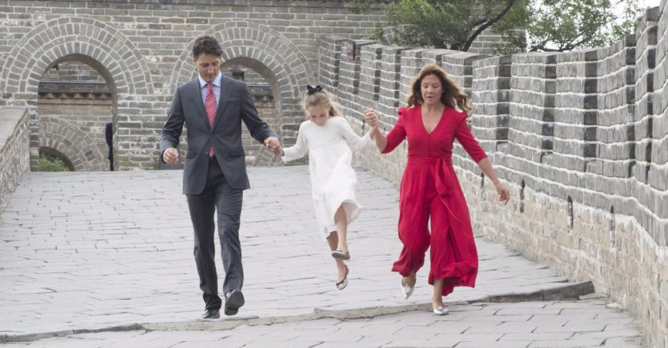 Prime Minister Justin Trudeau and Sophie Gregoire hold Ella-Grace's hand as she jumps over a drainage pipe as they visit a section of the Great Wall of China, in Beijing on Sept. 1, 2016. THE CANADIAN PRESS/Adrian Wyld