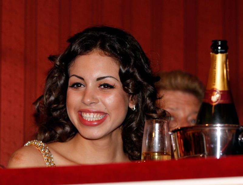 Karima el-Mahroug enjoys the traditional Opera Ball at the state opera in Vienna, Austria on Thursday, March 3, 2011. Karima el-Mahroug nicknamed Ruby, is the woman at the centre of a sex scandal which is engulfing Italian Prime Minister Silvio Berlusconi. (AP Photo/Ronald Zak)