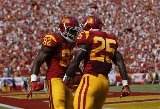 Southern California running back Silas Redd, right, celebrates his touchdown with tight end Randall Telfer during the first half of an NCAA college football game against California in Los Angeles, Saturday, Sept. 22, 2012. (AP Photo/Jae C. Hong)