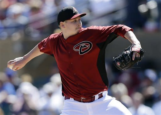 Arizona Diamondbacks starting pitcher Trevor Cahill throws to the Chicago Cubs during the first inning of an exhibition spring training baseball game on Monday, March 11, 2013 in Scottsdale, Ariz. (AP Photo/Marcio Jose Sanchez)