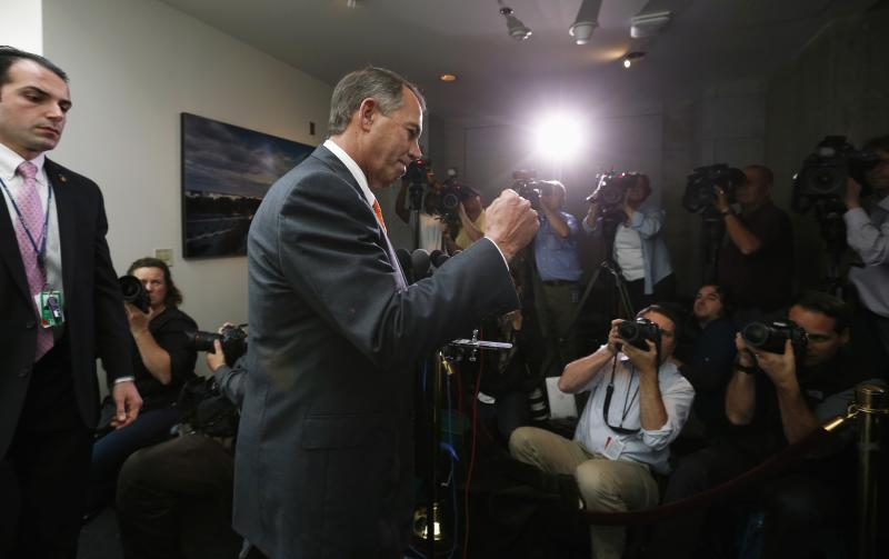 Speaker of House Boehner pumps fist as he emerges from meeting with Republican House members in U.S. Capitol in Washington
