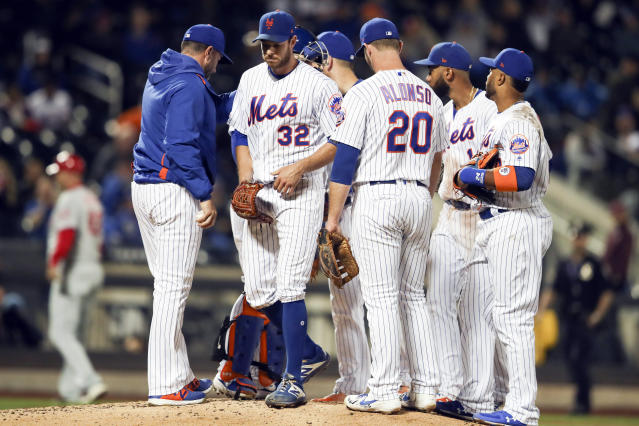 New York Mets manager Mickey Callaway, left, removes starting pitcher Steven Matz (32) during the sixth inning of a baseball game against the Philadelphia Phillies, Friday, Sept. 6, 2019, in New York. (AP Photo/Mary Altaffer)