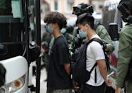 Dozens of democracy supporters were arrested in Hong Kong Thursday for defying a protest ban as the city marked China's National Day