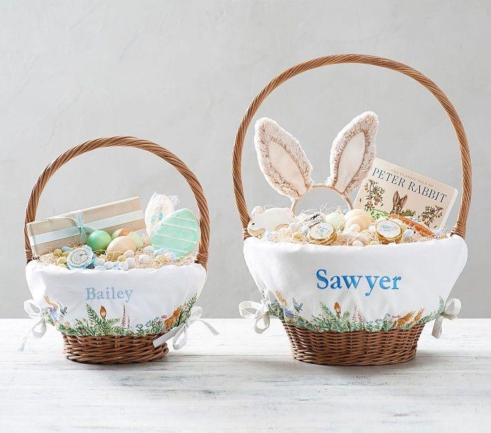 """<p><strong>pottery barn</strong></p><p>potterybarnkids.com</p><p><strong>$24.50</strong></p><p><a href=""""https://go.redirectingat.com?id=74968X1596630&url=https%3A%2F%2Fwww.potterybarnkids.com%2Fproducts%2Fpeter-rabbit-liners%2F&sref=https%3A%2F%2Fwww.thepioneerwoman.com%2Fholidays-celebrations%2Fg35785443%2Fpersonalized-easter-baskets%2F"""" rel=""""nofollow noopener"""" target=""""_blank"""" data-ylk=""""slk:Shop Now"""" class=""""link rapid-noclick-resp"""">Shop Now</a></p><p>These sweet, storybook-inspired baskets feature illustrations of Peter Rabbit playfully strolling through a garden scene. They come in a variety of sizes.</p>"""