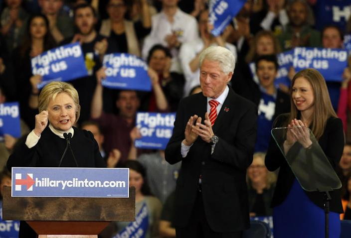Hillary Clinton speaks to supporters, with her husband, Bill, and daughter, Chelsea, at her side, at her primary night party in Hooksett, N.H. (Photo: Jessica Rinaldi/The Boston Globe via Getty Images)