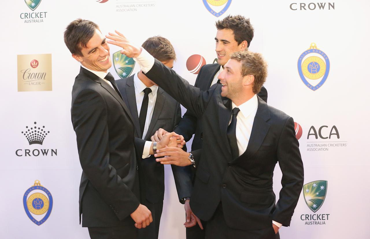 MELBOURNE, AUSTRALIA - FEBRUARY 04:  Patrick Cummins, Mitchell Starc and Phillip Hughes of Australia arrive during the 2013 Allan Border Medal awards ceremony at Crown Palladium on February 4, 2013 in Melbourne, Australia.  (Photo by Scott Barbour/Getty Images)