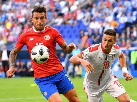 Soccer Football - World Cup - Group E - Costa Rica vs Serbia - Samara Arena, Samara, Russia - June 17, 2018 Costa Rica's Francisco Calvo in action with Serbia's Dusan Tadic REUTERS/Dylan Martinez