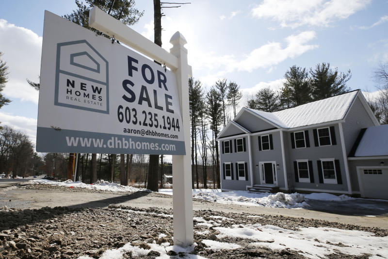 """A """"For Sale"""" sign stands in front of a newly constructed home in Londonderry, N.H., Thursday, Feb. 20, 2020. U.S. home sales retreated 1.3% in January from the prior month, but low mortgage rates helped enable an increase in purchases from a year ago. (AP Photo/Charles Krupa)"""