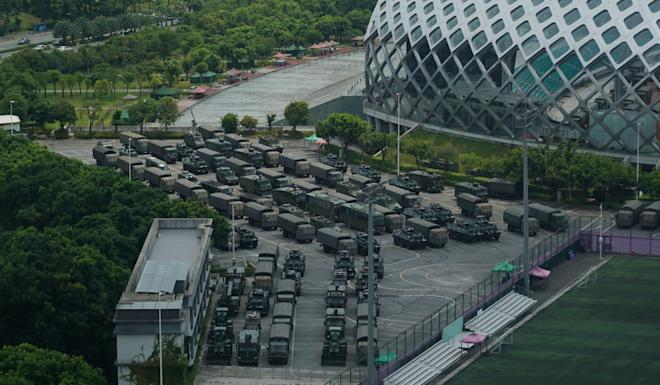 Vehicles of China's paramilitary, the People's Armed Police, parked alongside Shenzhen Bay Stadium on August 16. Photo: AP