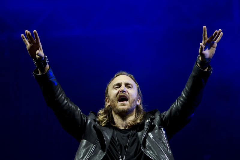"""FILE - This Sept. 13, 2013 file photo shows French recording artist David Guetta performing at the opening night of the 5th annual Rock in Rio music festival, in Rio de Janeiro, Brazil. Guetta will project a full-length music video for his new track """"One Voice"""" onto the exterior of the United Nations Secretariat Building, Friday, Nov. 22, to launch """"The World Needs More"""" campaign. (AP Photo/Felipe Dana, File)"""