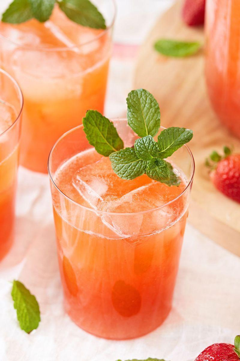 """<p>Freshly squeezed lemons team up with juicy strawberries for the perfect summer drink. It's tart, sweet, and all around refreshing. Be sure to strain the strawberry puree as you'll get rid of seeds and excess pulp. Mint adds a nice brightness. but is totally optional! </p><p>Get the <a href=""""https://www.delish.com/uk/cocktails-drinks/a33333158/easy-strawberry-lemonade-recipe/"""" rel=""""nofollow noopener"""" target=""""_blank"""" data-ylk=""""slk:Strawberry Lemonade"""" class=""""link rapid-noclick-resp"""">Strawberry Lemonade</a> recipe.</p>"""