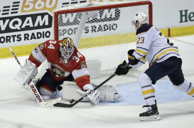 Florida Panthers' James Reimer (34) stops the puck on a shot by Buffalo Sabres' Sam Reinhart (23) during the second period of an NHL hockey game, Saturday, April 7, 2018, in Sunrise, Fla. (AP Photo/Lynne Sladky)