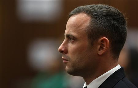 South African Olympic and Paralympic athlete Oscar Pistorius sits in the dock during his murder trial in the North Gauteng High Court in Pretoria April 17, 2014. REUTERS/Themba Hadebe/Pool