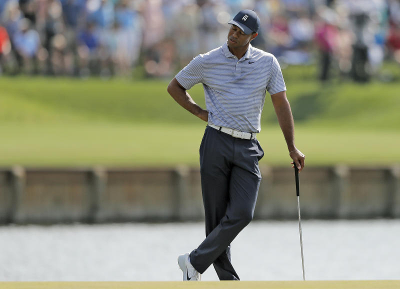 Tiger Woods reacts to hitting his drive into the water on the 17th hole during the second round of The Players Championship golf tournament Friday, March 15, 2019, in Ponte Vedra Beach, Fla. (AP Photo/Gerald Herbert)