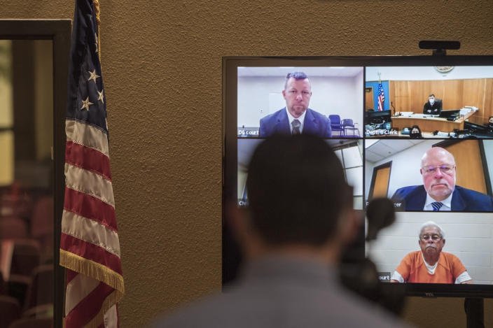 FILE - In this Thursday, April 15, 2021, file photo, defendants Paul Flores, top left, and his father, Ruben Flores, bottom right, appear via video conference during their arraignment in San Luis Obispo Superior Court in San Luis Obispo, Calif. The father and son were arrested on Tuesday, April 13, 2021, in connection with the 1996 disappearance of Kristin Smart, a college student at California Polytechnic University San Luis Obispo. The San Luis Obispo district attorney's office said that on Wednesday, July 14, 2021, it sought to add two rape charges for offenses after Smart disappeared to the complaint filed against Paul Flores in Smart's death. The judge ruled against the DA's motion. Flores was the last person seen with Smart on May 25, 1996, at California Polytechnic State University in San Luis Obispo. Her body has never been found. (AP Photo/Nic Coury, File)