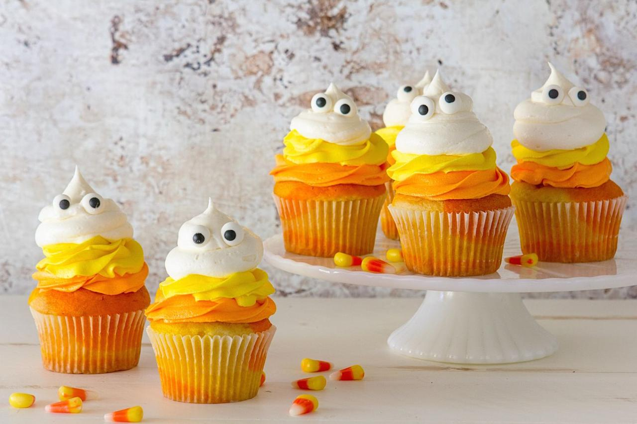 """<p>Mimic the layers of candy corn you love so much with these adorable cupcakes.</p><p>Get the recipe from <a href=""""https://www.delish.com/cooking/recipe-ideas/recipes/a43940/candy-corn-ghost-cupcakes-recipe/"""">Delish</a>.</p>"""