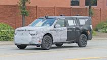 """<p>This mysterious Ford SUV was driving in Dearborn, Michigan, leaving Ford's development center. It was caught dressed in heavy camouflage.</p> <h3><a href=""""https://www.motor1.com/news/436953/mystery-ford-suv-spied-michigan/"""" rel=""""nofollow noopener"""" target=""""_blank"""" data-ylk=""""slk:Mystery Three-Row Ford SUV Spied Driving Around Dearborn"""" class=""""link rapid-noclick-resp"""">Mystery Three-Row Ford SUV Spied Driving Around Dearborn</a></h3> <h2>The News From Ford:</h2><br><a href=""""https://www.motor1.com/news/437816/2021-ford-broncos-trail-damage/"""" rel=""""nofollow noopener"""" target=""""_blank"""" data-ylk=""""slk:2021 Ford Broncos Show Damage From Rubicon Trail Rock Crawling"""" class=""""link rapid-noclick-resp"""">2021 Ford Broncos Show Damage From Rubicon Trail Rock Crawling</a><br><a href=""""https://www.motor1.com/news/437787/ford-fusion-buick-regal-production-discontinued/"""" rel=""""nofollow noopener"""" target=""""_blank"""" data-ylk=""""slk:Ford Fusion, Buick Regal Production Ends As Sedans Continue Decline"""" class=""""link rapid-noclick-resp"""">Ford Fusion, Buick Regal Production Ends As Sedans Continue Decline</a><br>"""