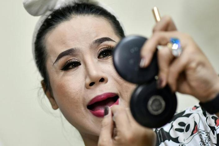 """""""We perform with our sweat, tears and blood,"""" says La Kim Quyen of the Sai Gon Tan Thoi LGBT lotto troupe in Vietnam (AFP Photo/Manan VATSYAYANA)"""
