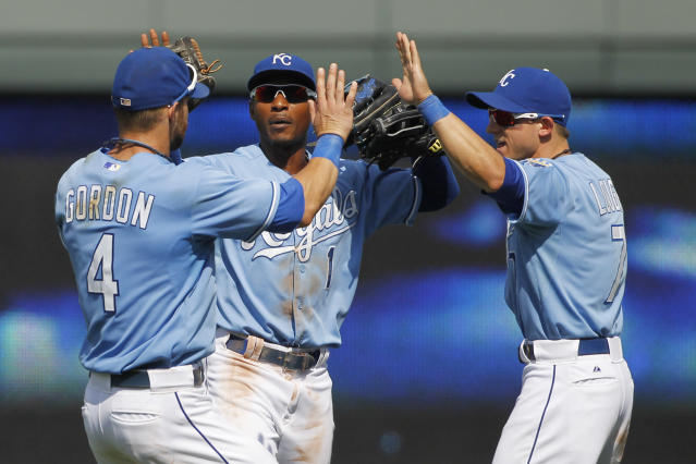 Kansas City Royals left fielder Alex Gordon (4) center fielder Jarrod Dyson (1) and right fielder David Lough (7) celebrate their 4-3 win over the Boston Red Sox at the end of a baseball game at Kauffman Stadium in Kansas City, Mo., Sunday, Aug. 11, 2013. (AP Photo/Colin E. Braley)