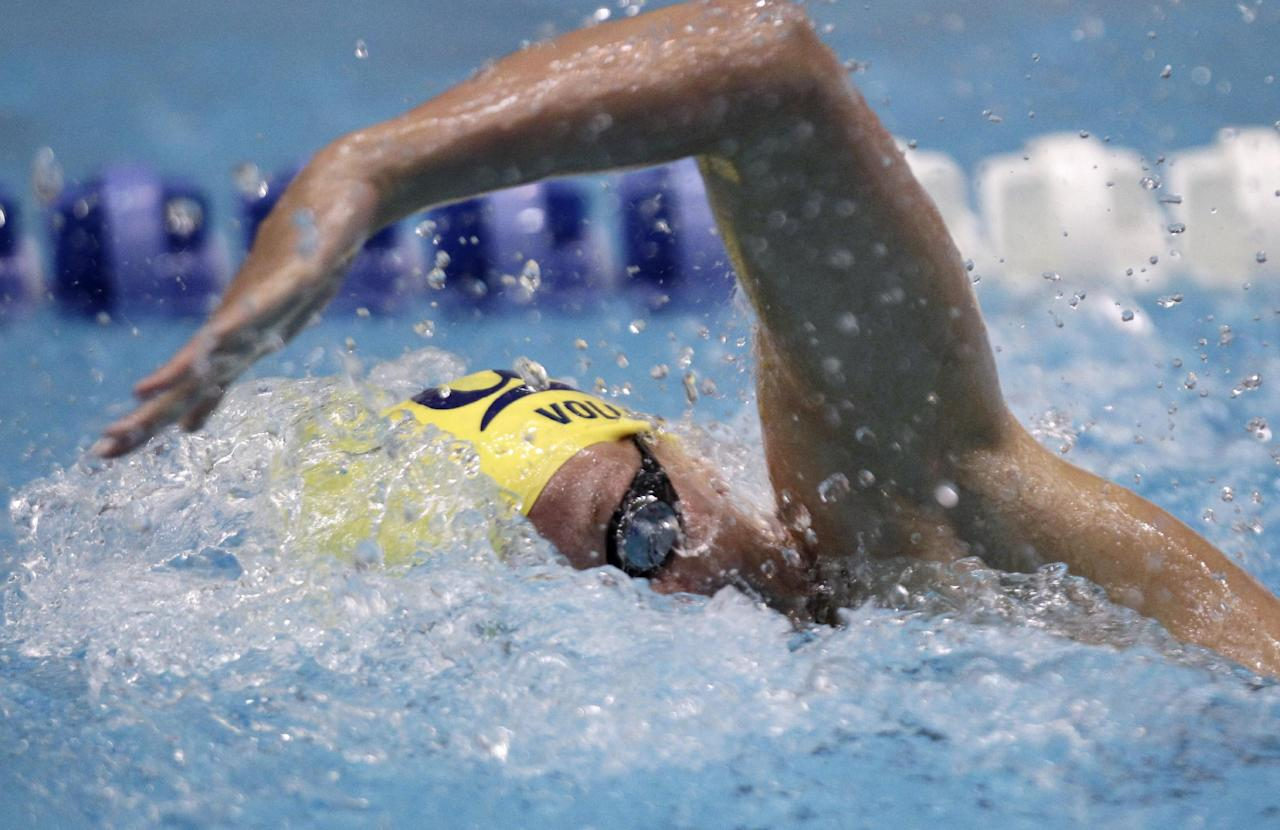 Dana Vollmer swims the women's 100-meter freestyle at the Indianapolis Grand Prix swim meet in Indianapolis, Thursday, March 29, 2012. Volmer won with a time of 54.21 seconds. (AP Photo/Michael Conroy)