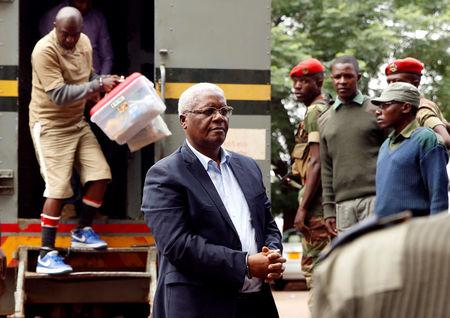 Former Zimbabwe finance minister Ignatius Chombo arrives at court to face corruption charges, in Harare