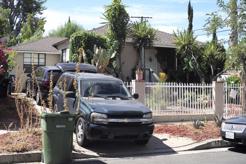 Cars are parked in the driveway of Robert Chain's house in the Encino section of Los Angeles on Thursday Aug. 30 2018. Chain who was upset about The Boston Globe's coordinated editorial response to President Donald Trump's attacks on the