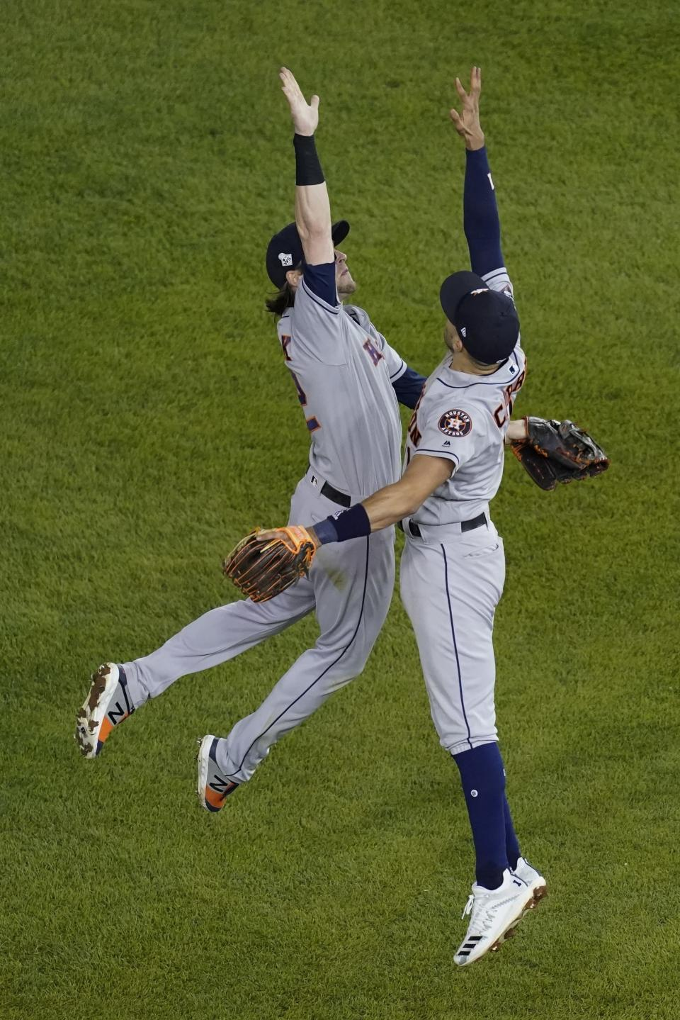 Houston Astros' Carlos Correa and Josh Reddick celebrate after Game 3 of the baseball World Series against the Washington Nationals Saturday, Oct. 26, 2019, in Washington. The Astros won 4-1. (AP Photo/Pablo Martinez Monsivais)